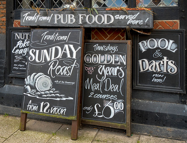Photo: Chalk boards outside a typical British pub