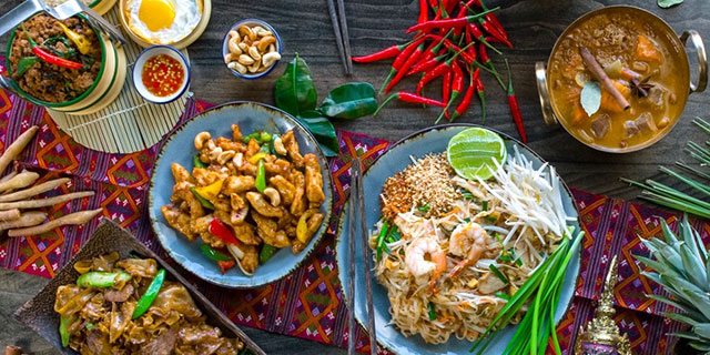 plates of colorful Thai food